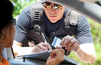 Police officer writing out a traffic citation